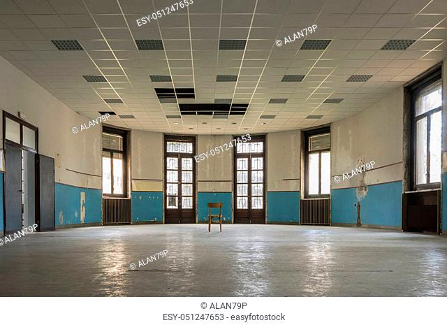 Internal room of old and abandoned devastated school, ready for renovation