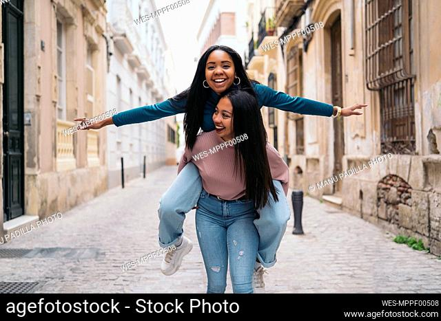 Two happy young women having fun in the city