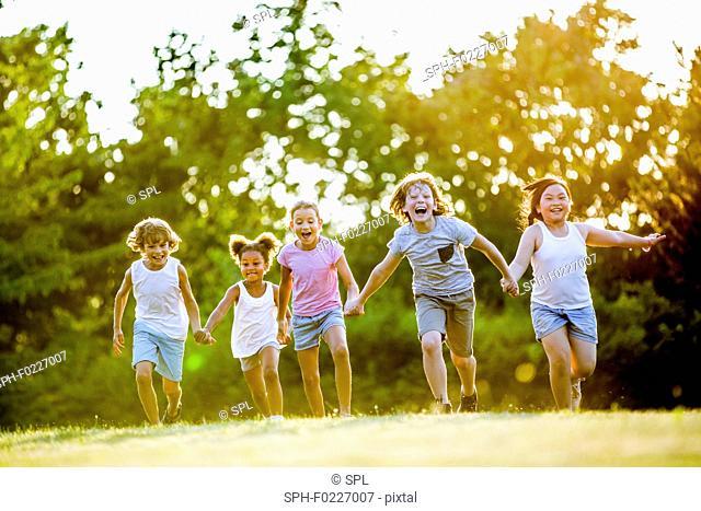 Children holding hands and running