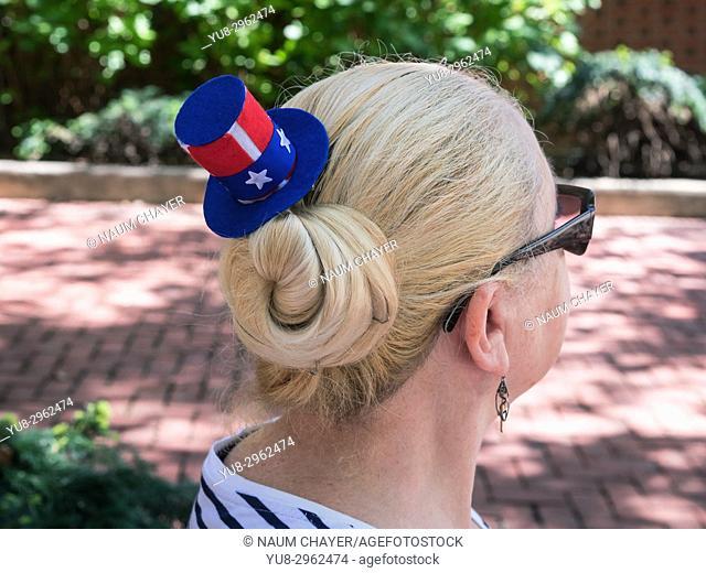 Tourist woman with American souvenir hat, Philadelphia, Pennsylvania, USA