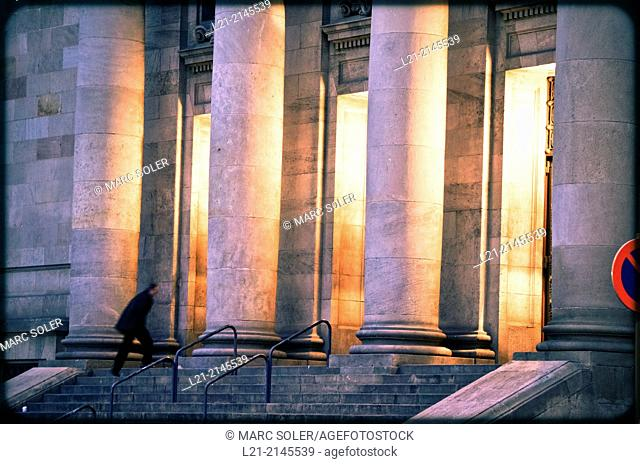 Columns and interior light at dusk, night. View of central post office building designed by Josep Goday Casals and Jaume Torres Grau