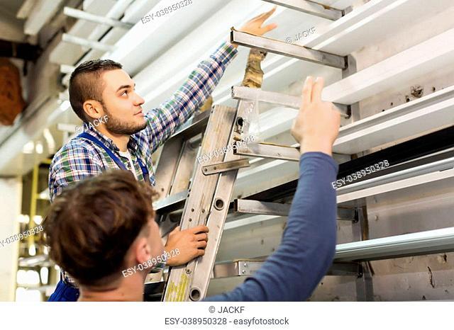 workmen choosing PVC profile at factory
