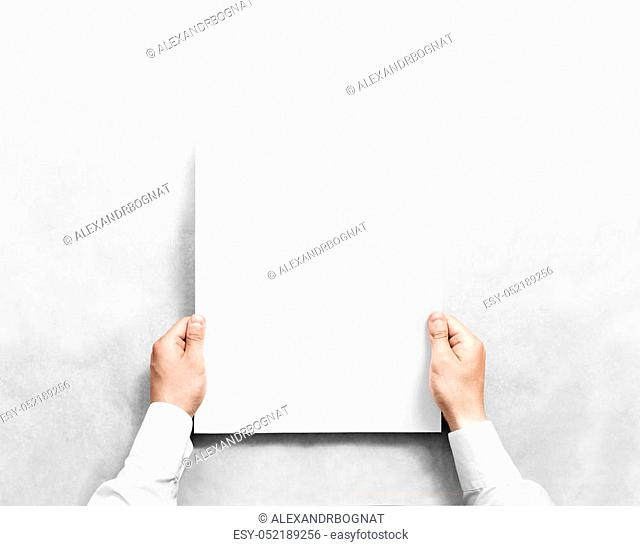 Hand holding white blank poster mockup, isolated. Arm in shirt hold clear broadsheet template mock up. Affiche bill surface design