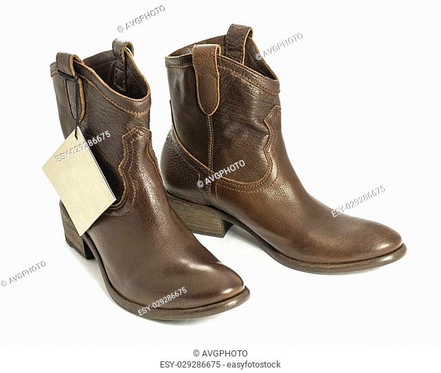Close-up of a brown leather cowboy boots, new with tag, isolated on white. Clipping path included