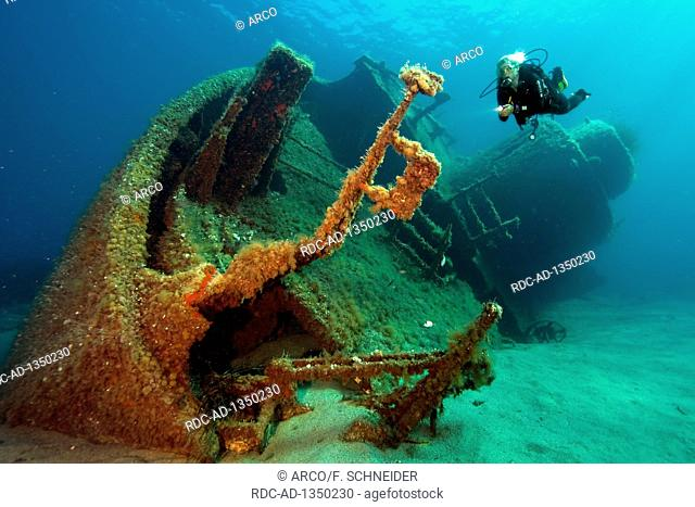 scuba diver at wreck, MV Elviscot, built in 1960, sunk in 1972, ran aground, first name KEIZERSGRACHT, depth 13 m, southwest coast off Pomonte, Elba, Tuscany