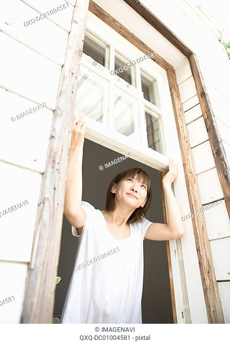 A woman opening the window