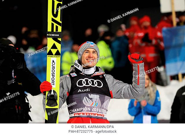 Kamil Stoch from Poland celebrates his victory at the Four Hills Tournament in Bischofshofen, Austria, 6 January 2017. Photo: Daniel Karmann/dpa | usage...