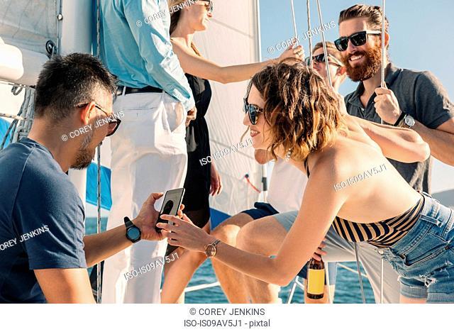 Friends having fun on sailboat