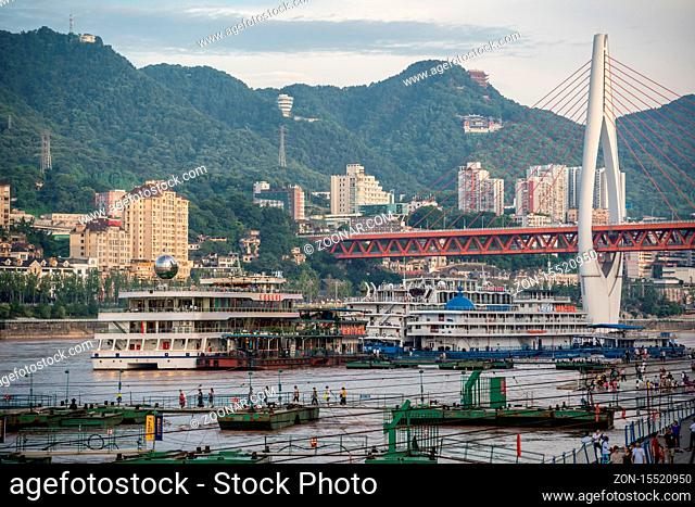Chongqing, China - August 2019 : Luxury passenger cruise ship ready to depart from Chongqing wharf on a trip through the Three gorges on the Yangtze river in...