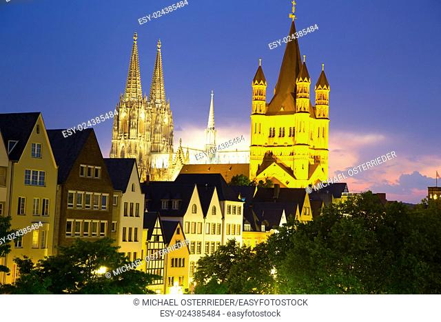 Nightly view on the cathedral of Cologne as well as the famous church Sankt Martin in the center of the city