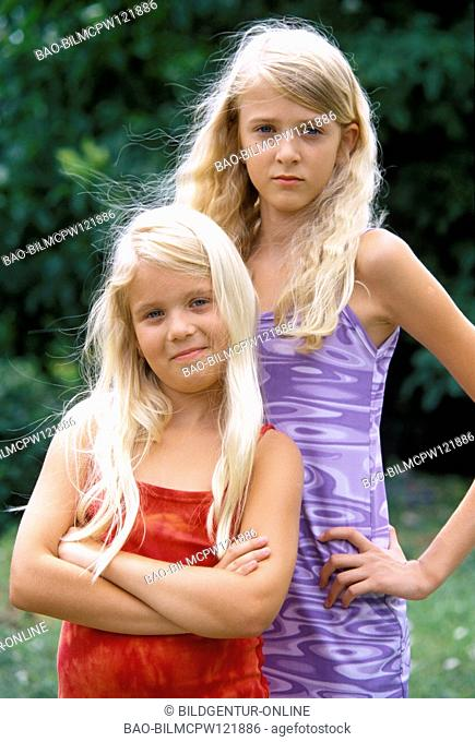 Two blond girls, half portrait