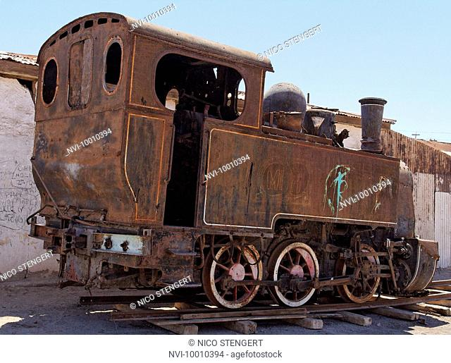 Old rusty steam train in the deserted ghost town Humberstone, Atacama, Chile, South America