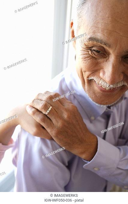 Senior man holding hands, close-up