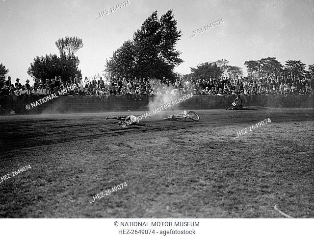 Fallen rider in a speedway race at Lea Bridge Stadium, Leyton, London, 1928.  Artist: Bill Brunell