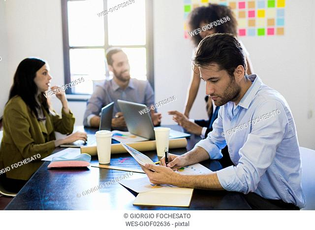 Businessman analyting data during a meeting in office