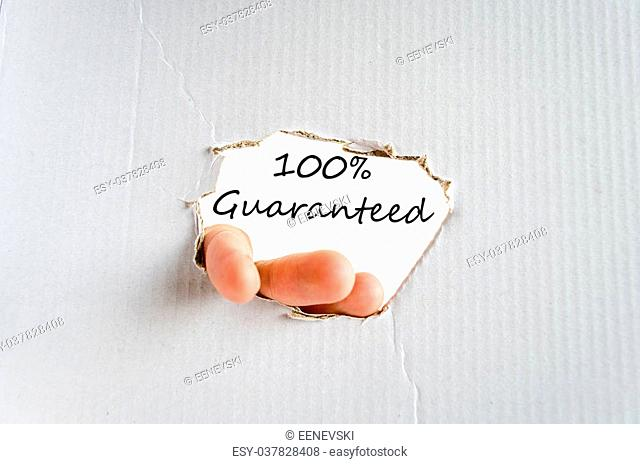 Hand and text on the cardboard background Guaranteed concept
