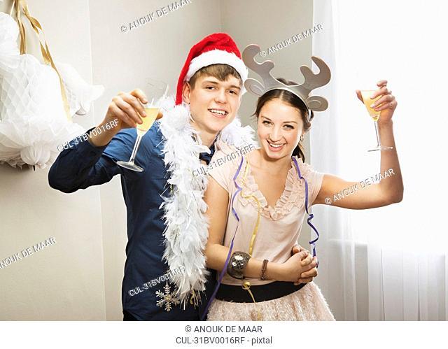 Couple raising champagne glasses