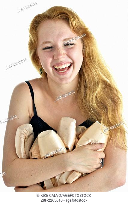 Auburn teen holding all her pointe ballet shoes