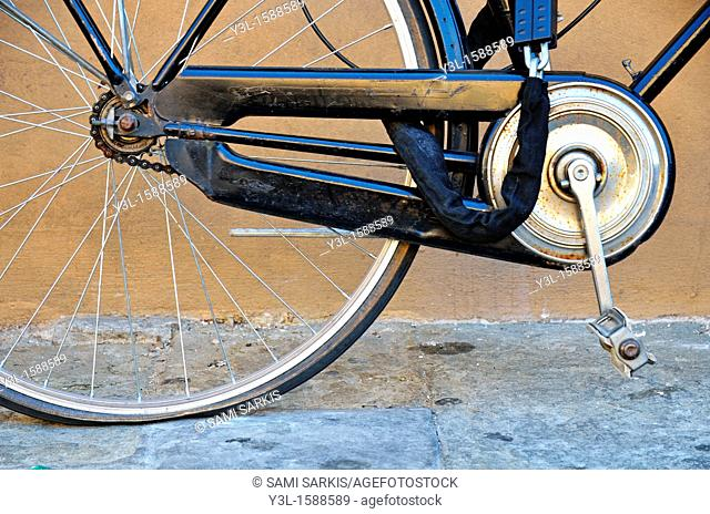 Bicycle with deflated rear tire, Florence, Italy
