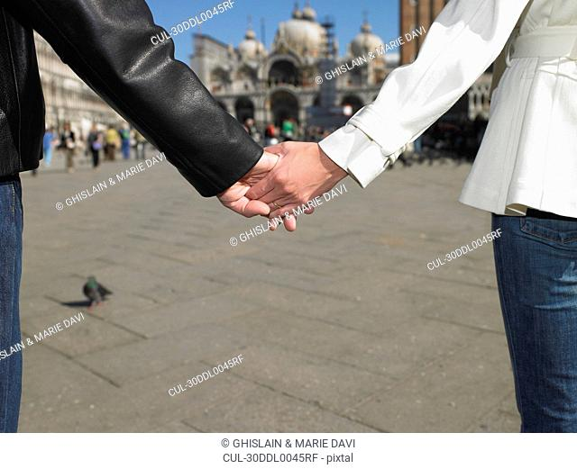Couple holding hands in Venice, Italy
