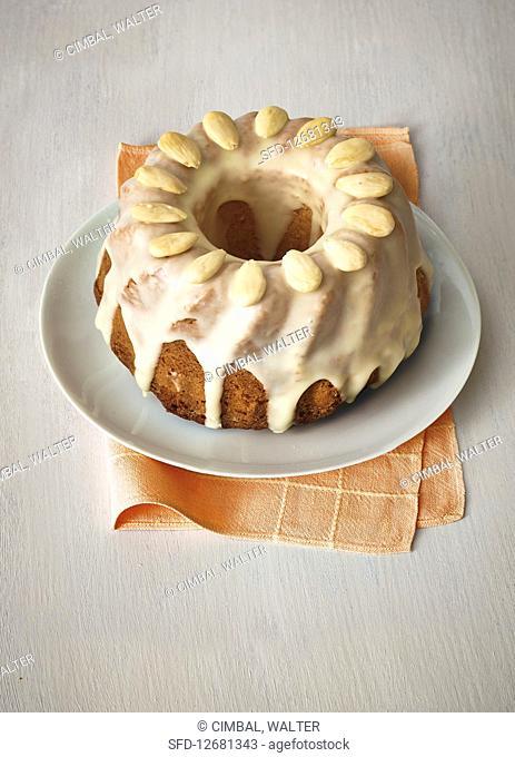 A mini orange cake with almonds