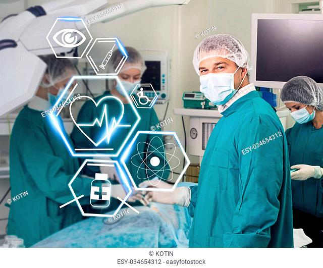Surgery team in a surgical room with futuristic healthcare icons