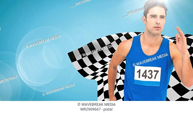 Male runner sprinting against blue background with flare and checkered flag
