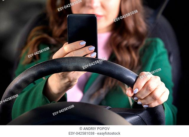 Close-up Of A Woman's Hand Traveling By Car Using Smartphone