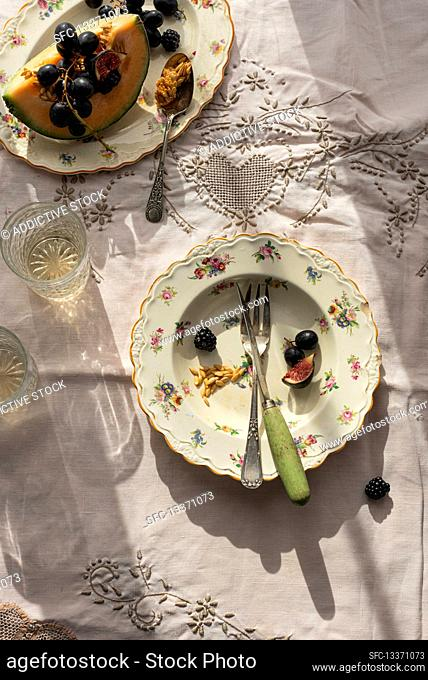 Melon and grapes on plates