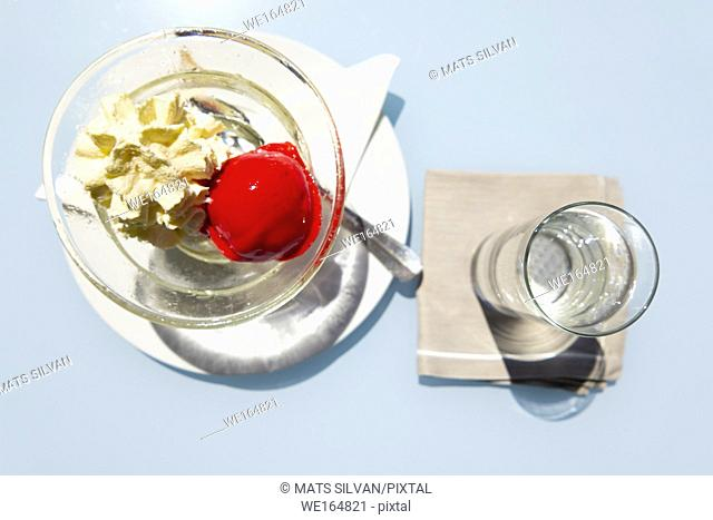 Strawberry Ice Cream and Glass of Water from Above in Ascona, Switzerland