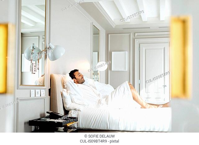 Man relaxing in suite