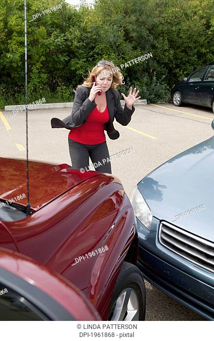 a woman makes a phone call for help after she gets into a car accident, edmonton, alberta, canada