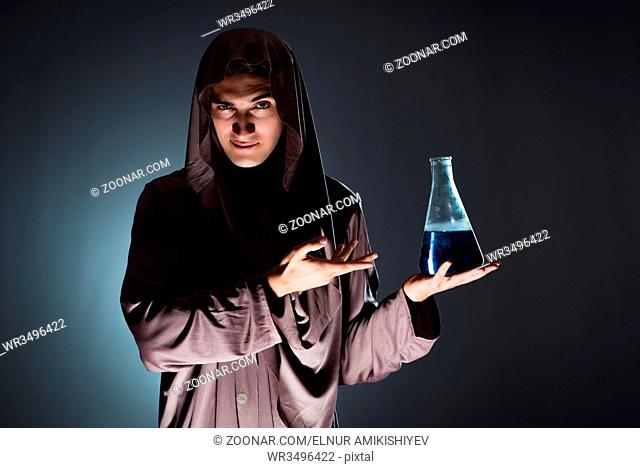 Alchemist doing experiments in alchemy concept