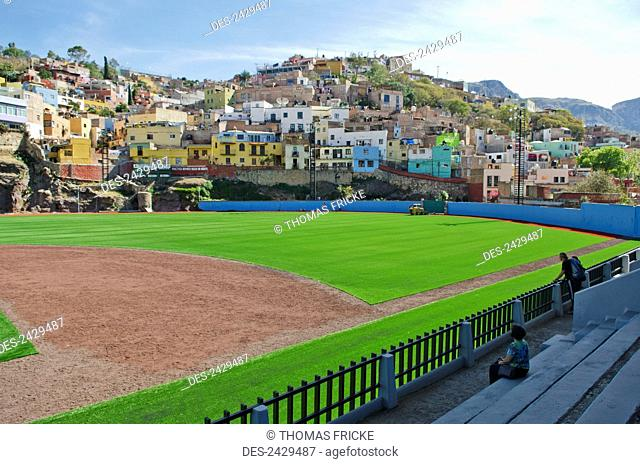 Baseball park surrounded by old spanish mountainside homes; Guanajuato, Mexico