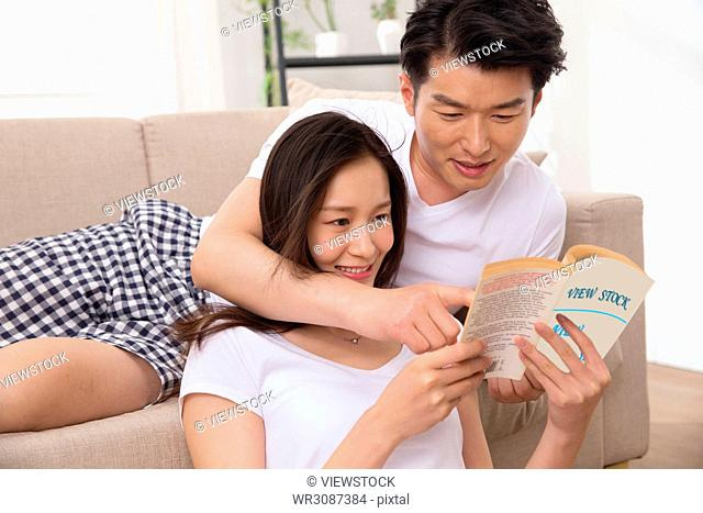 Young lovers read books at home
