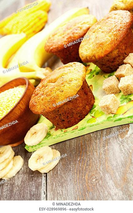 Corn muffins with bananas on the table