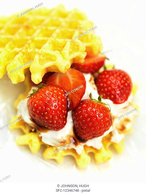 Waffles with strawberries and cream (close-up)