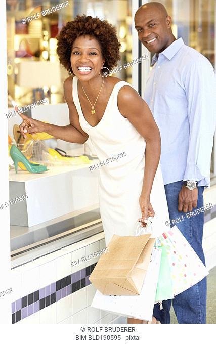 African American couple window shopping