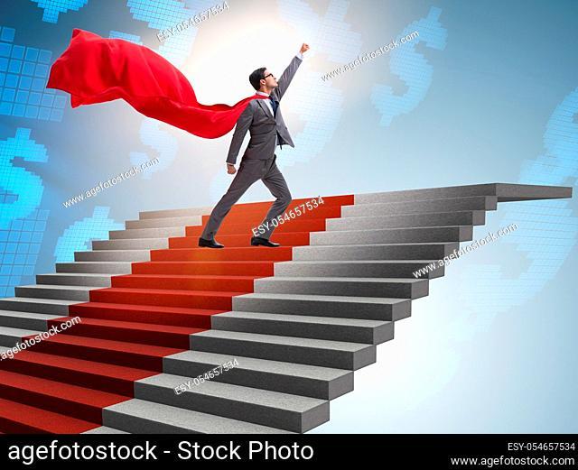 The superhero businessman climbing red carpet stairs