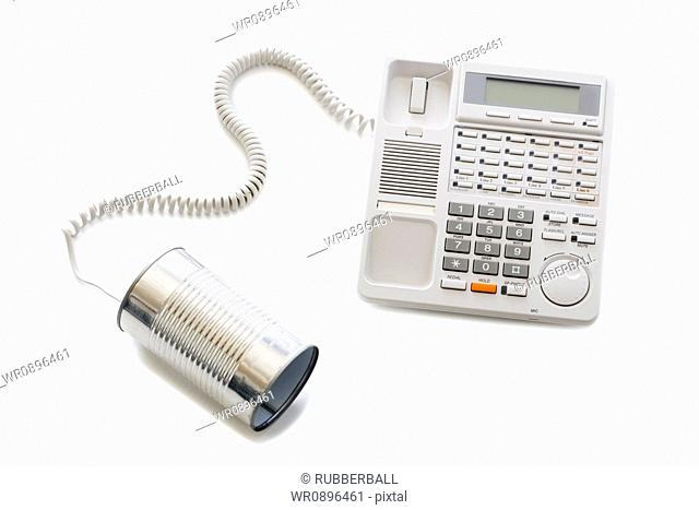 Telephone with can attached to cord
