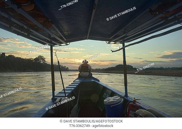 Navigating the Tambopata River at sunrise, Tambopata National Reserve, Peruvian Amazon