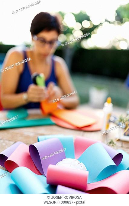 Woman making a cardboard rosette