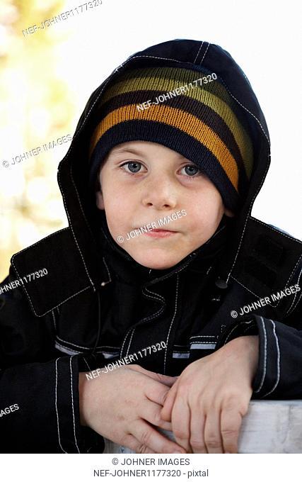 Boy wearing hooded top, portrait