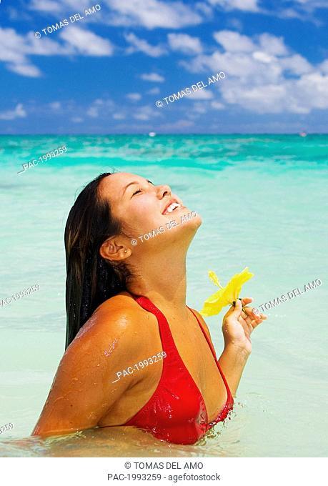 Hawaii, Beautiful Hawaiian Girl With Hibiscus In Ocean, Smiling Joyfully