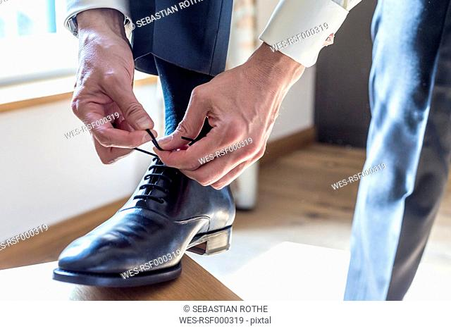 Man tying shoes, close up