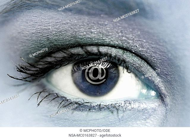 In the eye of a woman is reflected in an @-sign