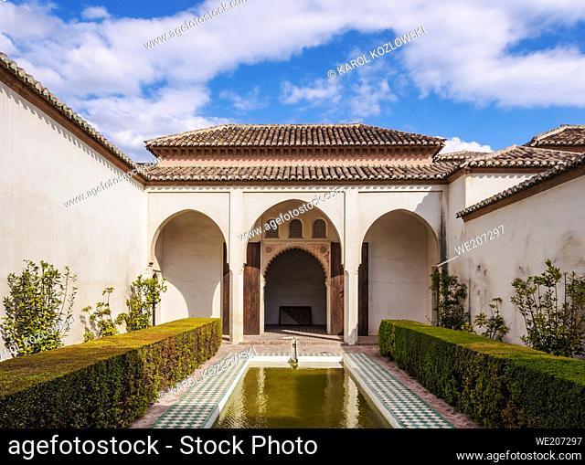 Courtyard garden of the Cuartos de Granada in The Alcazaba, Malaga, Andalusia, Spain