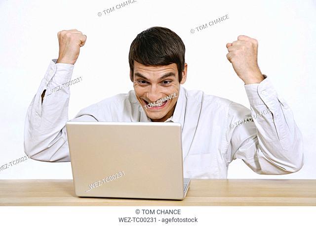 Man using laptop, portrait