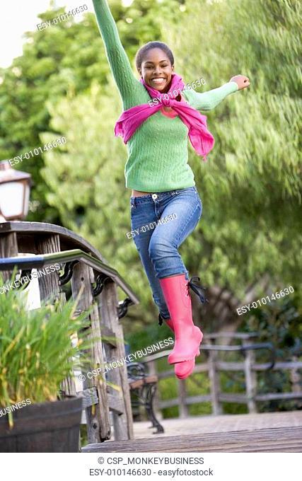 Teenage Girl Frolicking Outdoors