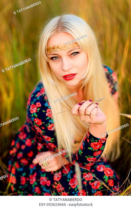 girl with long white hair walks through the autumn park